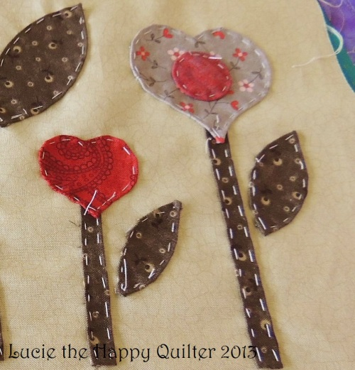 Applique patches tacked to background