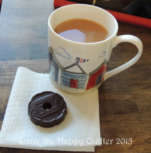 Tea and chocolate ginger biscuit