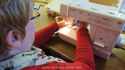 Ann quilting her 9 patch challenge