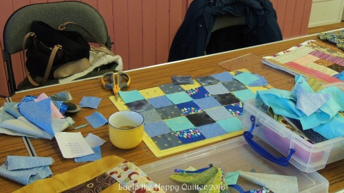 Lynn organising her postage stamp quilt